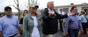 President Trump and First Lady Melania walk through a San Juan suburb
