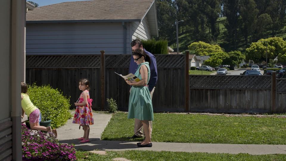A family in a suburban neighborhood