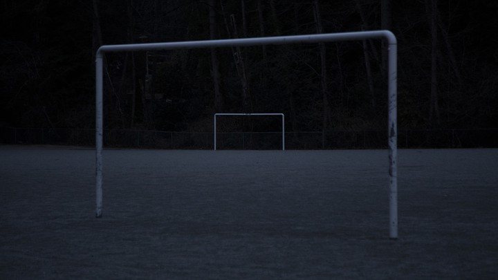 An abandoned soccer field in the dark