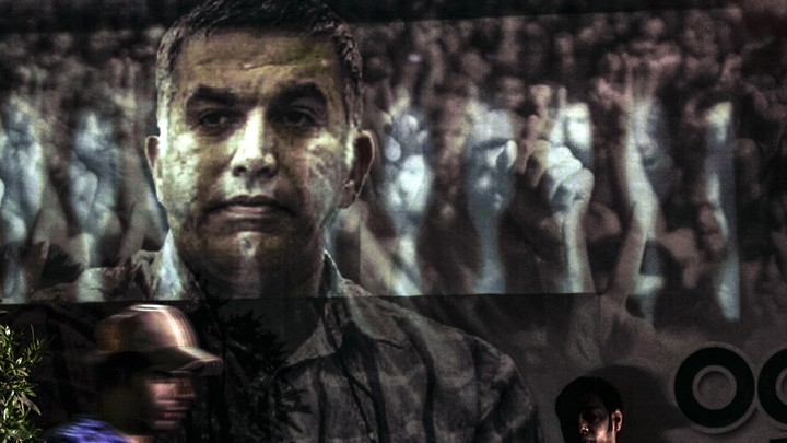 A banner of Bahraini activist Nabeel Rajab hanging  outside his family's home in Bani Jamra, Bahrain.