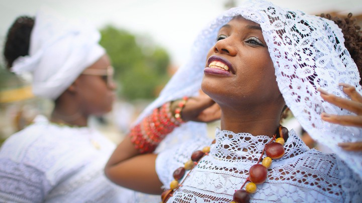 Women at a festival honoring an African goddess in February 2018