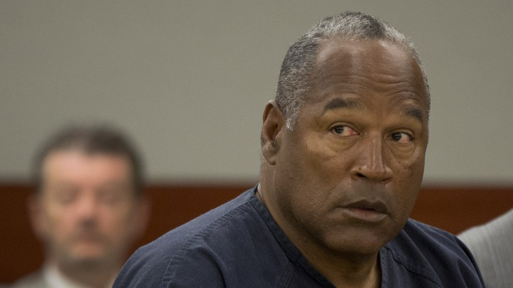 O.J. Simpson listens during an evidentiary hearing in Clark County District Court in Las Vegas, Nevada, on May 16, 2013.
