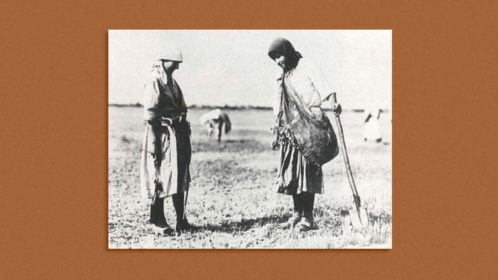 Two women standing with shovel
