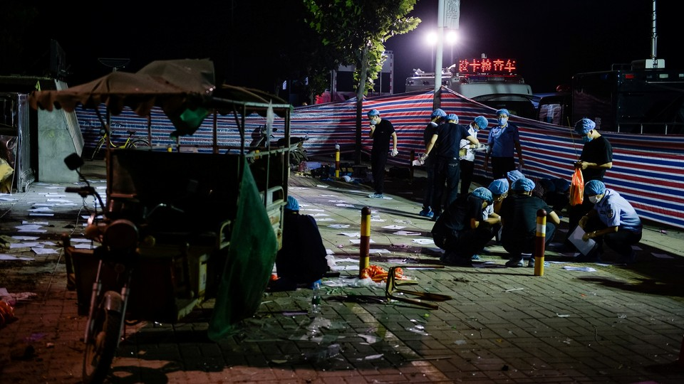 Forensic experts work at the site of the explosion in Xuzhou City on June 16, 2017.