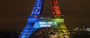 """a photo of the Eiffel Tower with the words """"Made for Sharing"""" projected on it"""