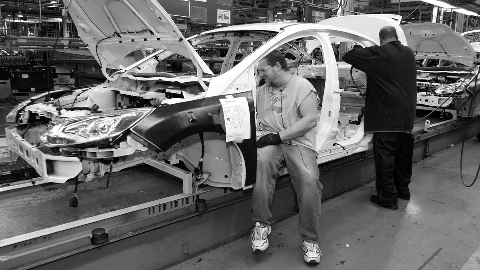 Workers build a Ford Focus on the assembly line at the Ford Motor Company's Michigan Assembly Plant on December 14, 2011, in Wayne, Michigan.