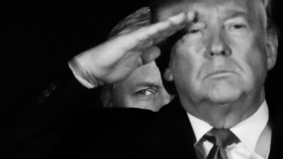 White House National Security Adviser Robert O'Brien stands behind President Donald Trump as he salutes.