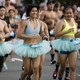 A group of runners wearing light-blue running tutus