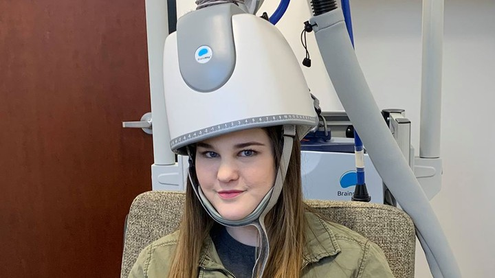 "Bre Hushaw wears the BrainsWay ""depression helmet"" at a clinic in Arizona."