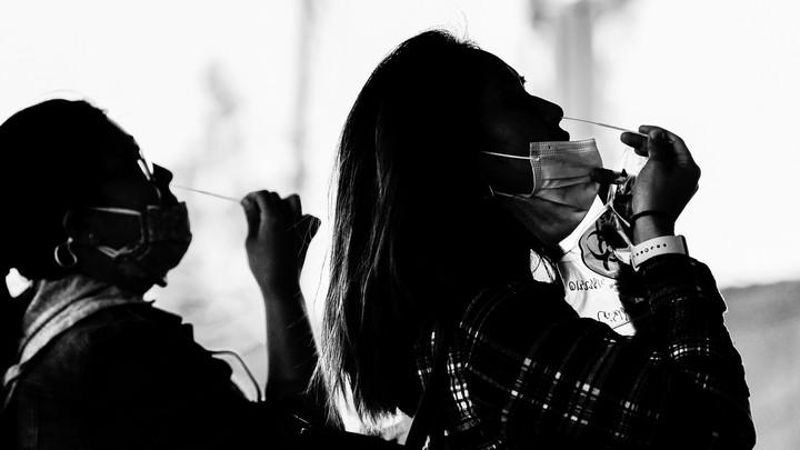 Two women wearing face masks.