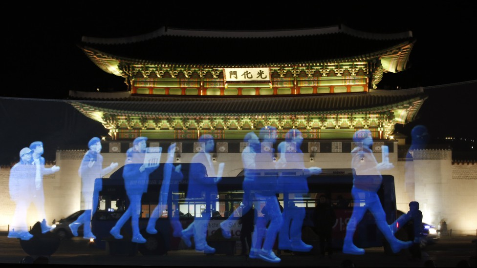 Holograms of protesters are shown in front of Gyeongbok Palace in South Korea