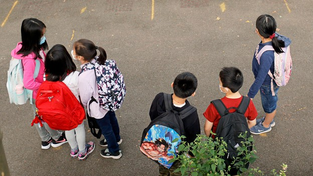 children in masks gathered at a New York elementary school