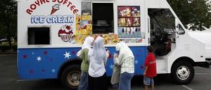 Buying ice cream from an ice cream truck.