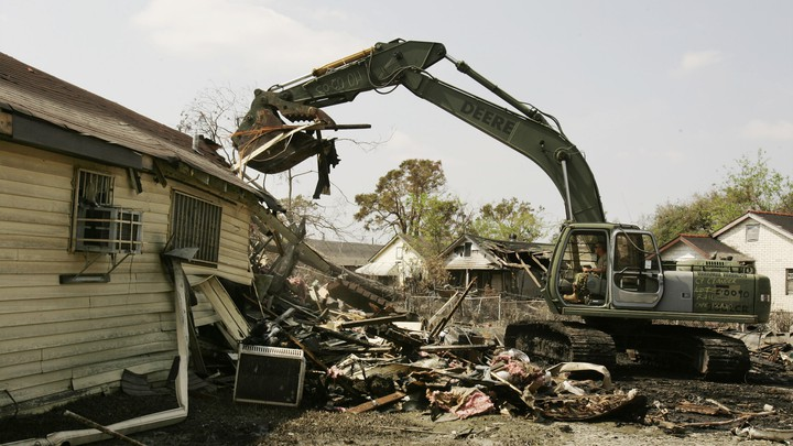 Members of the National Guard clear debris from the roads in New Orleans on September 15, 2005