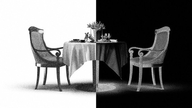A dinner table in black-and-white