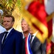 Emmanuel Macron stands at a ceremony alongside two other French officials.
