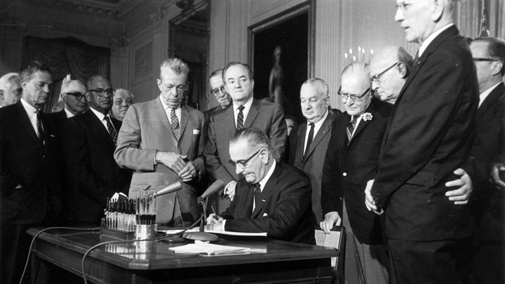 President Lyndon Johnson signs the Civil Rights Act on July 2, 1964.