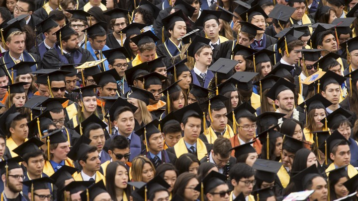 A sea of graduates in caps and gowns