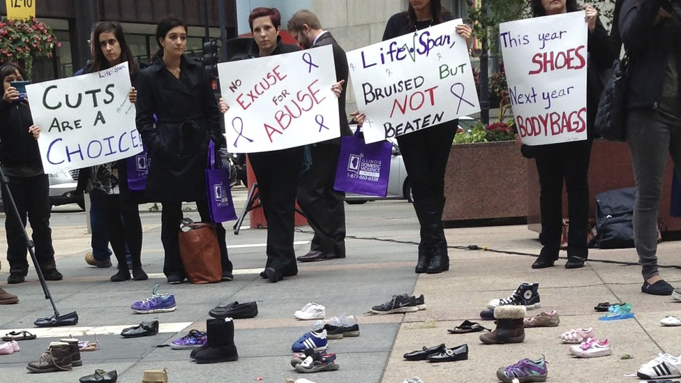 Advocates for victims of domestic abuse protest in downtown Chicago in 2015.