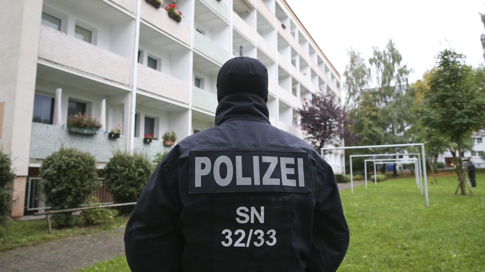 German special policemen SEK search a housing area in the eastern city of Chemnitz on suspicion that a bomb attack was being planned.