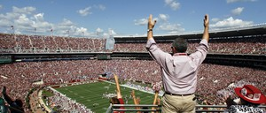 An Alabama fan celebrates during the first half of an NCAA college football game against Florida in Tuscaloosa, Alabama.