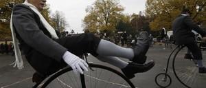 A nattily attired rider aboard a high-wheeler bike in the Czech Republic.