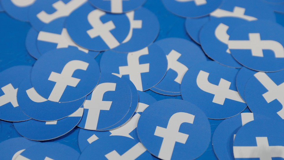 A pile of stickers bearing the Facebook logo