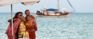 Tourists take a selfie on a beach in the coastal city of Larnaca, Cyprus.