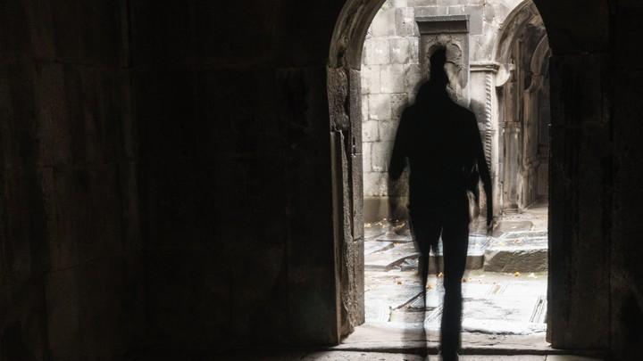 man walking out of a church door