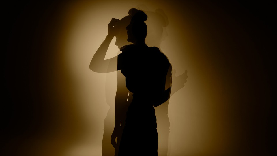 An image of a girl's silhouette in shadows