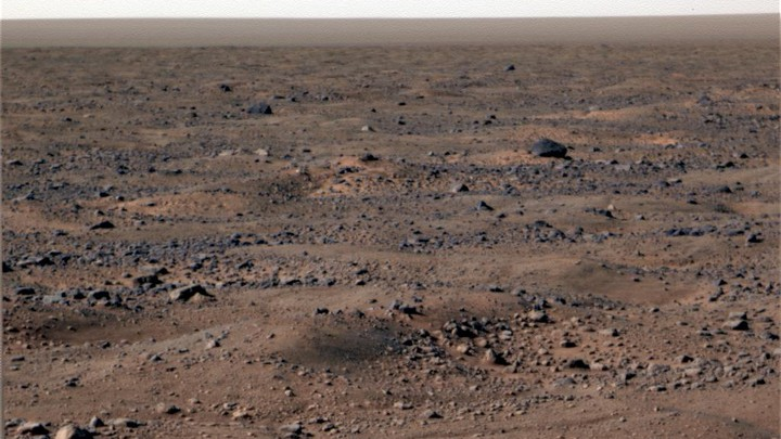 A rocky, dusty, pale brown and gray landscape with no signs of life