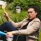 Jon Chu sitting in a lawn chair with bubbles