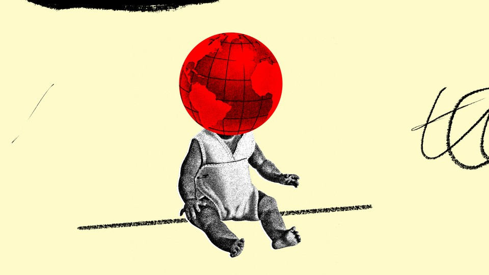 A black-and-white image of a baby with a red globe as his head