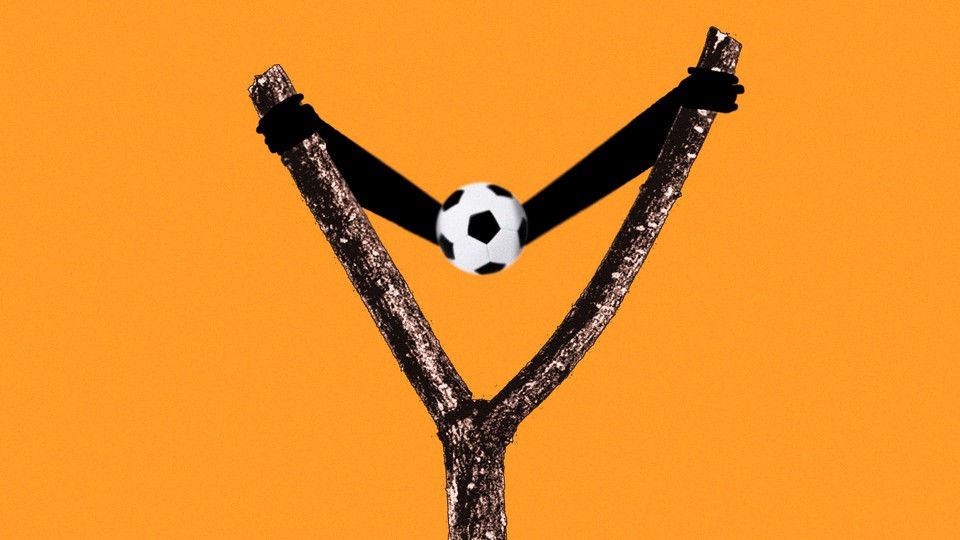 A slingshot with a soccer ball
