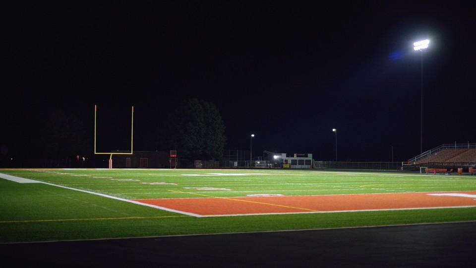 An empty football field at night.