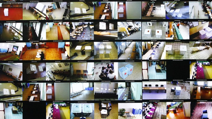 Screens show live footage from polling stations in Moscow during Russia's 2012 elections.