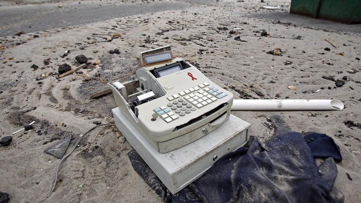 A cash register among debris