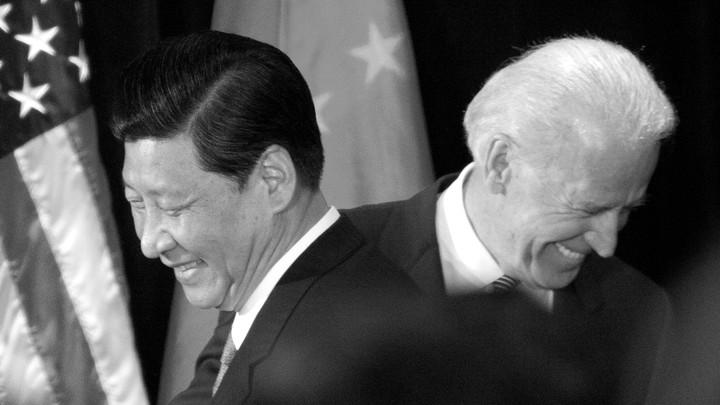 Joe Biden and Xi Jinping pass each other.