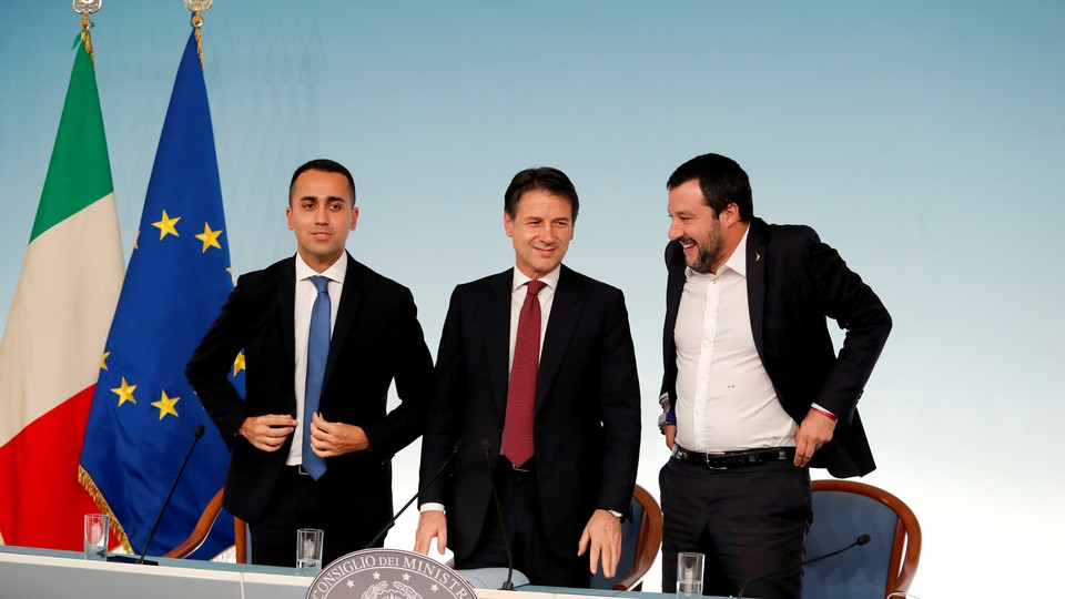Di Maio, Prime Minister Giuseppe Conte, and Salvini stand after a press conference in Rome.