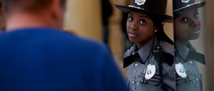 A photo of a security officer directs shoppers at the King of Prussia Mall.