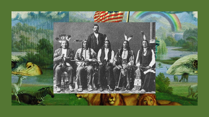 A black-and-white posed photograph of seated members of the Red Cloud delegation adorned in traditional regalia. Behind them stands a man in a suit.