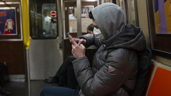 A man wearing a face mask on the subway