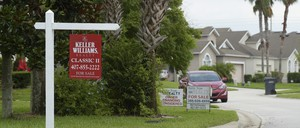 for sale signs on lawns