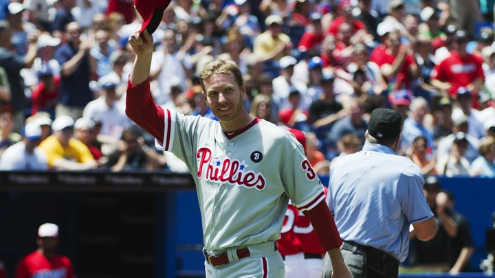 The Philadelphia Phillies pitcher Roy Halladay smiles and tips his hat to the crowd before his team plays the Toronto Blue Jays in a 2011 game in Toronto.