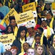 """People hold signs reading """"Let me learn,"""" """"United for school choice,"""" and """"Great teachers change lives."""""""