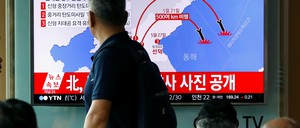 In Seoul, shoppers watch news reports about North Korean missile tests.