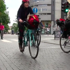 Bike riders cruise past a cafe in downtown Oslo, where the city hopes to ban all cars by 2019.