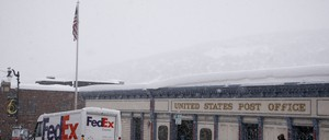A photo of a post office in the snow.