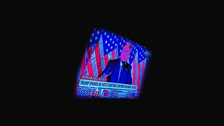 A television showing Donald Trump speaking, surrounded by a thick black border