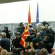 Police try to stop protesters entering Macedonia's parliament after the governing Social Democrats and ethnic Albanian parties voted to elect an Albanian as parliament speaker in Skopje,Macedonia.